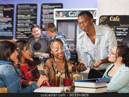 Impressive Man with Phone stock photo, Male student impressing women with phone in cafe by Scott Griessel