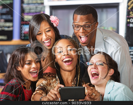 Laughing Students Holding Smartphone stock photo, Group of students taking self-portrait with camera phone by Scott Griessel