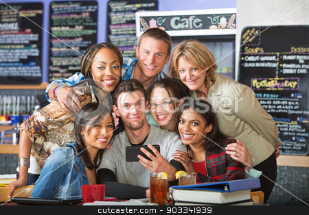 Cute Students Posing for Picture stock photo, Happy friends taking picture with phone in coffee house by Scott Griessel