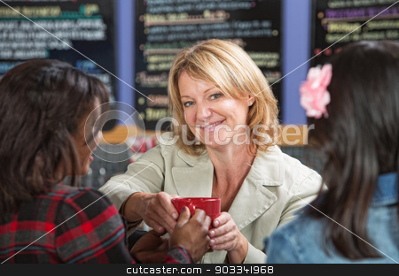 Woman Giving Coffee stock photo, Happy restaurant manager with customers and coffee by Scott Griessel