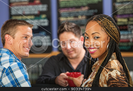 Woman Ordering Coffee stock photo, Beautiful smiling Black woman with coffee in cafe by Scott Griessel
