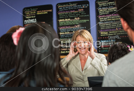 Stressed Out Cafe Owner stock photo, Overwhelmed coffee house owner taking orders from group by Scott Griessel