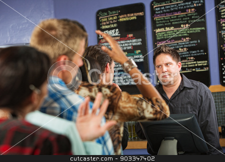Annoyed Male Cafe Worker stock photo, Annoyed male cafe worker with long line by Scott Griessel