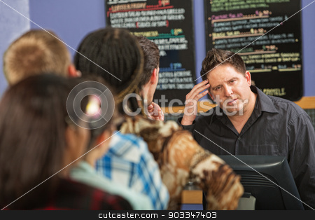 Long Line at Cafe stock photo, Confused barista at cash register in cafe by Scott Griessel