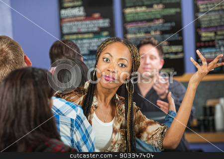 Annoyed Lady in Cafe stock photo, Annoyed young woman waiting in line at restaurant by Scott Griessel