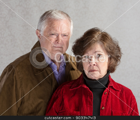 Grumpy Couple stock photo, Pair of serious senior adults in jackets by Scott Griessel