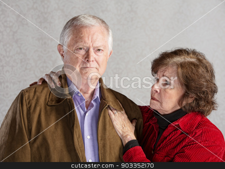 Concerned Senior Couple stock photo, Concerned senior husband and wife over gray background by Scott Griessel