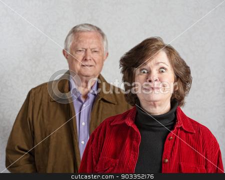 Woman Teasing Man stock photo, Funny senior European woman teasing confused man by Scott Griessel