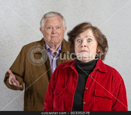 Startled Woman Near Man stock photo, Stiff older woman in front of confused man by Scott Griessel