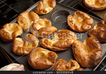 Traditional English Yorkshire puddings stock photo, Traditional English Yorkshire puddings made from batter in a baking tray waiting to accompany a meal of roast beef by Stephen Gibson