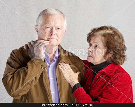 Worried Elderly Couple stock photo, Worried wife holding concerned husband in jacket by Scott Griessel