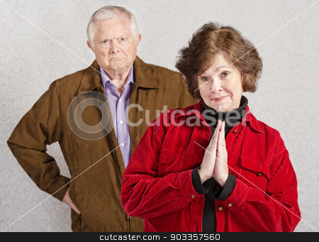 Coy Woman with Grumpy Man stock photo, Coy pretty older woman in front of grumpy man by Scott Griessel