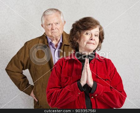 Innocent Lady with Grumpy Man stock photo, Grumpy old man behind beautiful innocent lady by Scott Griessel