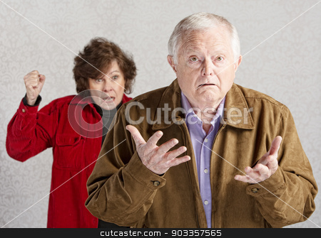Confused Senior Male stock photo, Confused elderly man with angry older woman by Scott Griessel
