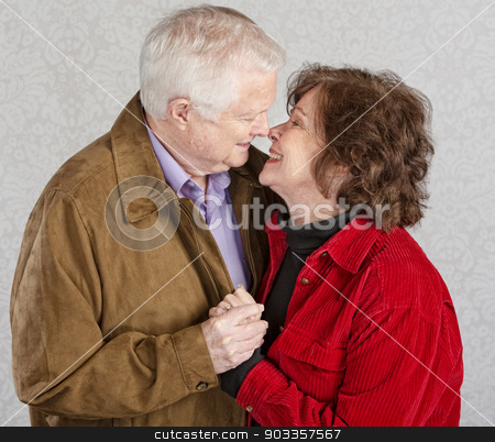 Cute Kissing Couple stock photo, Loving older man and woman kissing each other by Scott Griessel