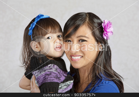 Mother Holding Daughter stock photo, Beautiful young Asian mother holding little girl by Scott Griessel