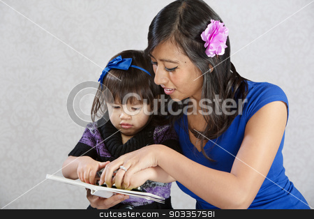 Mother Reading to Child stock photo, Pretty young Native American mother reading to toddler by Scott Griessel