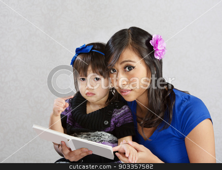 Reading to a Child stock photo, Cute child and young woman reading a story by Scott Griessel