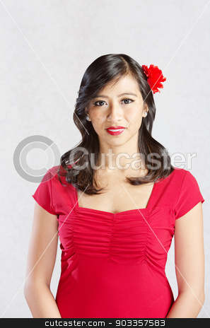 Smiling Woman in Red stock photo, Pretty Hispanic female in red with flower in hair by Scott Griessel