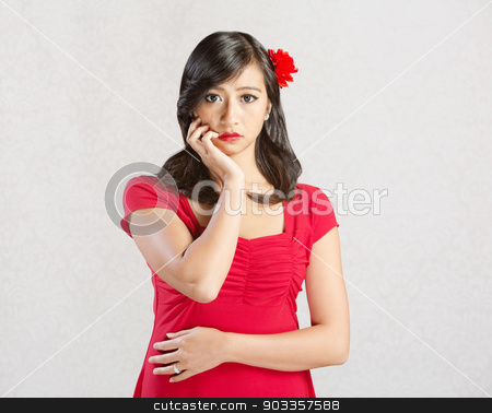 Woman with Blank Stare stock photo, Beautiful Asian female with hands near mouth by Scott Griessel
