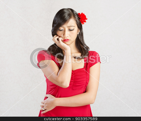 Woman Looking Sad stock photo, Sad young woman in read looking down by Scott Griessel