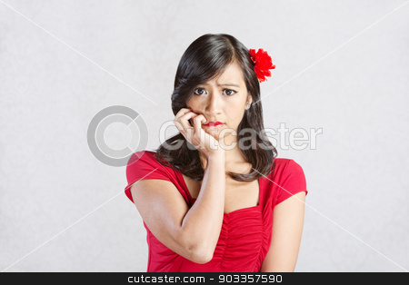 Stressed Out Lady stock photo, Stressed out young Hispanic female in red by Scott Griessel