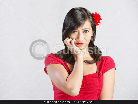 Grinning Young Woman stock photo, Beautiful young woman with grin and flower in hair by Scott Griessel