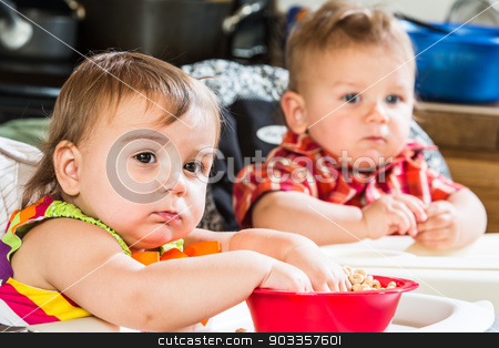 Babies Eat Breakfast stock photo, Two cute babies are eating breakfast together by Scott Griessel