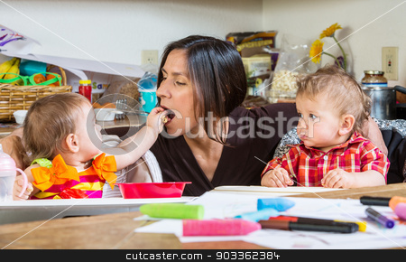 Baby Feeds Mother stock photo, A Baby feeds her mother at breakfast by Scott Griessel