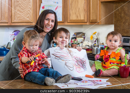Mother Poses With Children stock photo, Mother poses with children in the kitchen by Scott Griessel