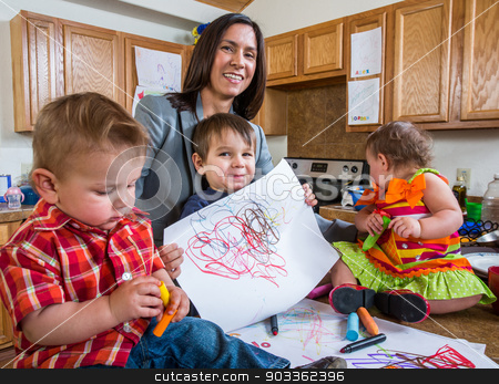 Child Poses With Drawing stock photo, Mother and child in kitchen pose with a drawing by Scott Griessel