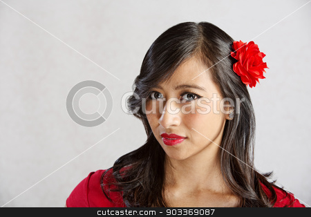 Lady with Sarcastic Grin stock photo, Skeptical young Asian woman with sarcastic grin by Scott Griessel