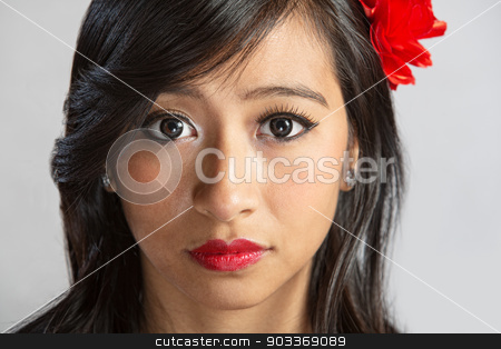 Close Up of Woman stock photo, Close up of serious beautiful Hispanic female by Scott Griessel