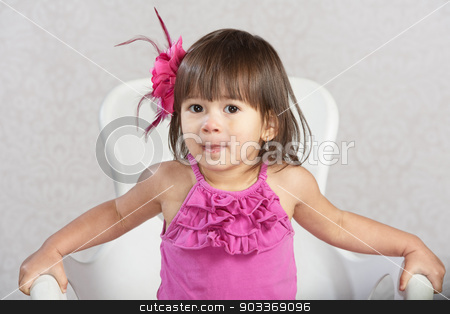 Uncomfortable Child stock photo, Uneasy little Hispanic child sitting in chair by Scott Griessel