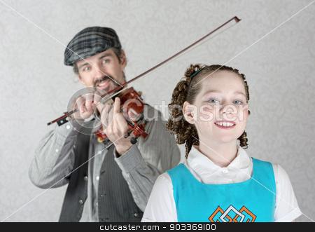 Irish Girl Listening to Fiddler stock photo, Cute Irish child listening to bearded man playing fiddle by Scott Griessel