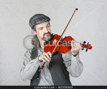 Handsome Irish Fiddler Performing stock photo, Single handsome Irish fiddler with beard playing music by Scott Griessel