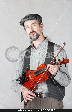 Serious Celtic Folk Musician stock photo, Serious Irish man with beard holding fiddle by Scott Griessel