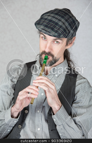 Celtic Folk Musician Playing Flute stock photo, Handsome Irish folk musician playing tin whistle by Scott Griessel