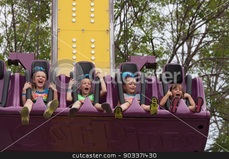 Girls on carnival ride at state fair stock photo, DES MOINES, IA /USA - AUGUST 10: Unidentified girls enjoy a carnival thrill ride at the Iowa State Fair on August 10, 2014 in Des Moines, Iowa, USA. by Scott Griessel
