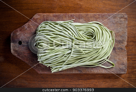 Pasta on wooden table. stock photo, Paste on old wooden table. by Pablo Caridad