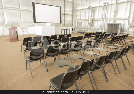Empty Presentation Conference Room stock photo, Empty Presentation Conference Room with Desk Chairs and Projector Screen. by Andy Dean