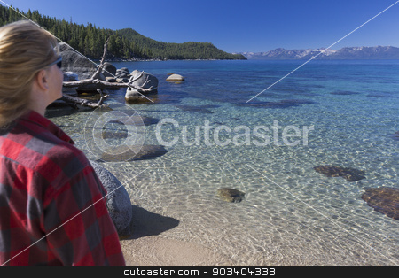 Woman Looking Over Beautiful Shoreline of Lake Tahoe. stock photo, Woman Looking Over Beautiful Clear Water Shoreline of Lake Tahoe. by Andy Dean