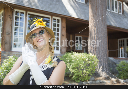Attractive Woman in Twenties Outfit Near Antique House stock photo, Attractive Young Woman in Twenties Outfit Near Antique House. by Andy Dean