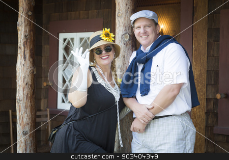 Attractive Couple Dressed in Outfits from the Twenties Era stock photo, Young Attractive Couple Dressed in Outfits from the Twenties Era. by Andy Dean