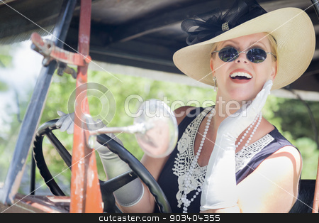 Attractive Woman in Twenties Outfit Driving an Antique Automobil stock photo, Attractive Young Woman in Twenties Outfit Driving an Antique Automobile. by Andy Dean
