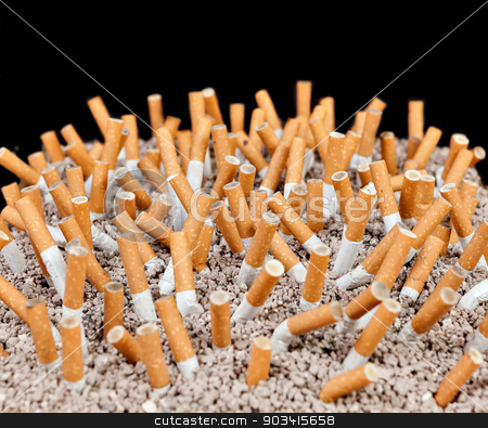 Cigarettes chaos stock photo, Ashtray full of smoked cigarettes in the sand by Dario Rota