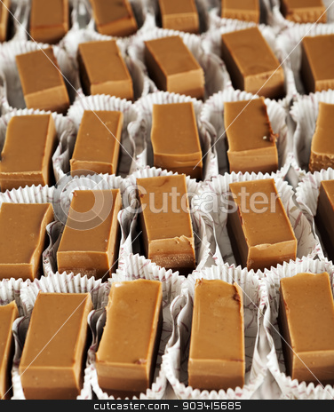 Chocolate sweet blocks stock photo, Block of chocolate sweets from above on a tray into their decorate wrapping by Dario Rota