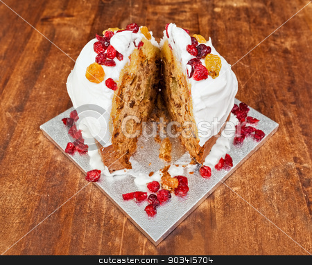 Christmas cake splitted stock photo, Christmas cake with cream and red berries cutted in two slices by Dario Rota