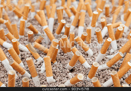 Cigarettes chaos closeup stock photo, Ashtray closeup full of smoked cigarettes in the sand by Dario Rota
