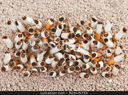 Cigarettes rectangle from above stock photo, Ashtray full of smoked cigarettes in the sand arranged as a rectangle by Dario Rota
